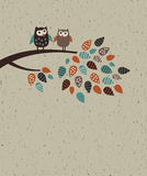 Owl family and leaves. The happy birds family on the brunch. Empty place for text. Color vector illustration on the craft textured background Stock Image