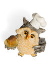 Owl figurine in nightcap with bread on a tray Royalty Free Stock Photography