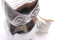 Owl figurines. Silver and white owl figurines Royalty Free Stock Photography