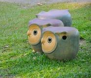 Owl garden stool on green lawn Royalty Free Stock Image