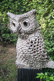 An owl in the garden. There is an handicrafted owl in the garden, it is used for the cage of lighting in the night stock photos