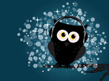 Owl with headphones. Standing on the branch Stock Photography
