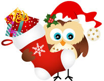 Owl holding Christmas stocking with gifts Royalty Free Stock Images
