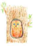 Owl in the hollow. Stock Photos