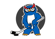 Owl ice hockey player with stick Stock Photography