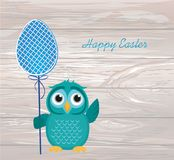 Owl keep Easter decorated egg on a stick.  Vector on wooden back Stock Photography