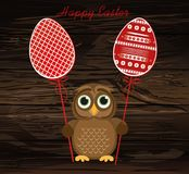 Owl keep Easter decorated egg on a stick.  Vector on wooden back Royalty Free Stock Images
