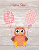 Owl keep Easter decorated egg on a stick.  Vector on wooden back Royalty Free Stock Photo
