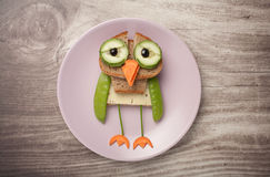 Owl made of bread and vegetables Royalty Free Stock Photo
