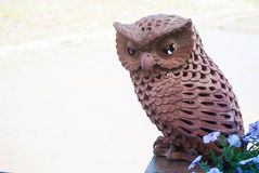Owl made by brown clay Stock Image