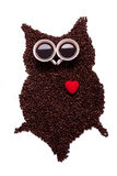 Owl, made of coffee seeds and two caps Stock Photos