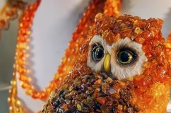 The owl made of particles of natural amber stock image