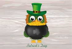 An owl in a national costume for a patrick`s day holds a pot o. F gold. Greeting card for the holiday with a blank space for text or advertising. Invitation Stock Photo