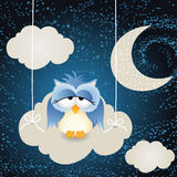 Owl on a night cloud sky background Stock Images
