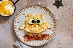Owl omelette for kids breakfast. Owl omelette with bacon for kids breakfast royalty free stock photos