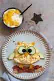 Owl omelette for kids breakfast. Owl omelette with bacon for kids breakfast royalty free stock image