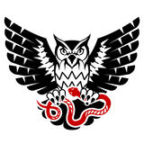 Owl with open wings attacking snake Royalty Free Stock Image