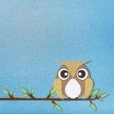 Owl perched paper craft on paper background Stock Photos