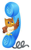 Owl and phone receiver Royalty Free Stock Images