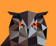 Owl in a polygon style. Fashion illustration of the trend in sty. Le on an orange background Royalty Free Stock Image