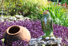 Owl and the pot. Landscaping beds. Owl and the pot Stock Images