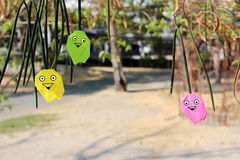 The Owl`s family. Origami Owl in the park stock image