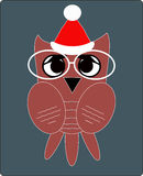 Owl in Santa Clauss hat, a flat style Royalty Free Stock Images