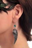 Owl shaped earring ear Royalty Free Stock Image