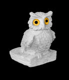 Owl. Statuette of white owl on black background Stock Images