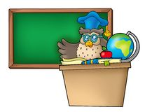 Owl teacher behind desk Royalty Free Stock Photography