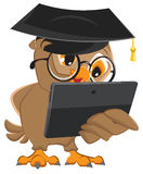 Owl teacher holds tablet computer Royalty Free Stock Photography