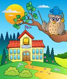 Owl teacher with school building Royalty Free Stock Photos