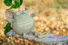 Owl toy and baby's bootees Royalty Free Stock Images