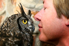 Owl and Trainer Royalty Free Stock Images