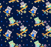 Owl vector seamless pattern.. Cute owl vector seamless pattern on a blue background Stock Photos