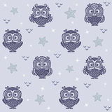 Owl wallpaper 2. Seamless background with a picture of owls moon and stars Royalty Free Stock Photo