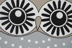 Owl with white dots on grey bac. Interesting decoration Royalty Free Stock Photos