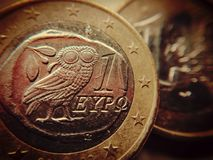 The owl of wisdom on a one-euro coin royalty free stock photo