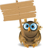 Owl and a wooden plaque Royalty Free Stock Photography