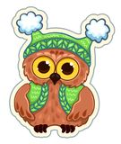 Owlet in knitted clothes Stock Images