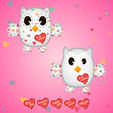 Owlet white in the hearts and on the wings Stock Photos