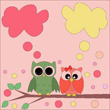 Owls on a branch with speech bubbles Stock Photo