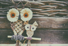 Owls. Decoration made by corn shells Royalty Free Stock Photo