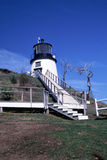 Owls Head Light Station, Rockland, ME. Landmark lighthouse at at Owls Head near Rockland, Maine. White stairways running obliquely up to the lighthouse tower set Royalty Free Stock Photography