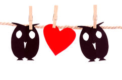 Owls and heart paper shapes hanging on a rope Royalty Free Stock Photography