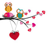 Owls and hearts. Cute and colorful harts hang on brand Stock Photos