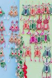 Owls made of jute, wall hangings - handicrafts on display. Colorful decorative wall hangings, owls made of jute, handicrafts on display with white background Stock Image