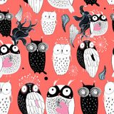 Owls on a red background Royalty Free Stock Photos