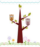 Owls  sitting on branches. Royalty Free Stock Photos