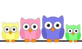 Owls are sitting on a wire Royalty Free Stock Image